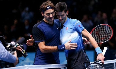Djokovic and Federer share a moment at the net after their round robin play in this year's ATP World Tour Finals.